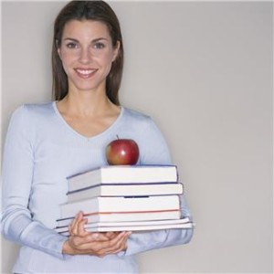 Teacher Holding Textbooks